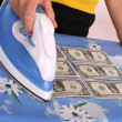 Ironing american dollars — Stock Photo