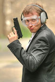 Male agent with gun — Stock Photo