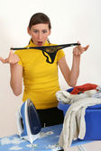 Female slip in laundry basket — Stock Photo