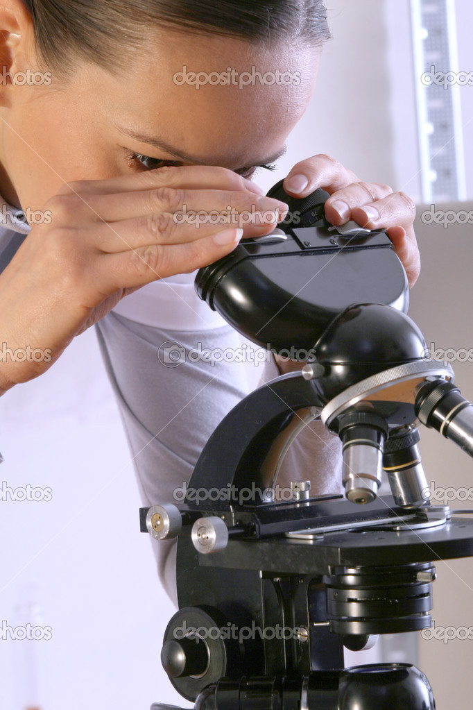 Scientist looks at a microscope in laboratory  Stock Photo #1598032