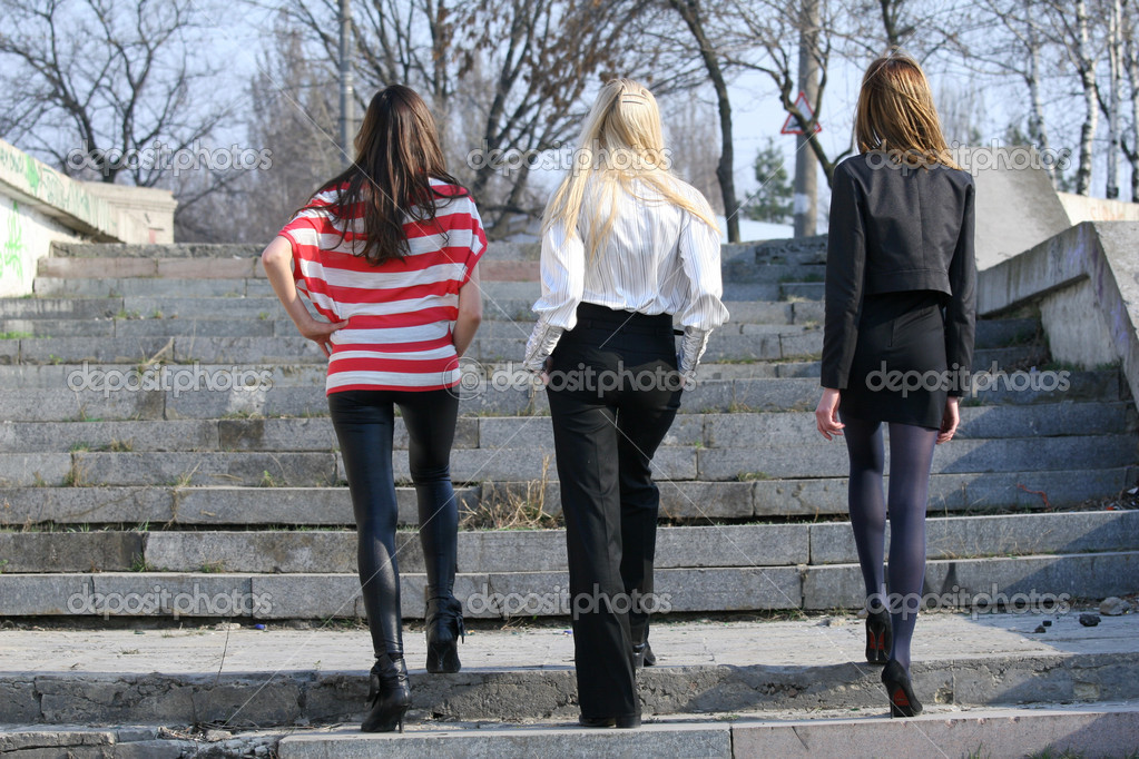 Three woman walking on the steps — Stock Photo #1608485