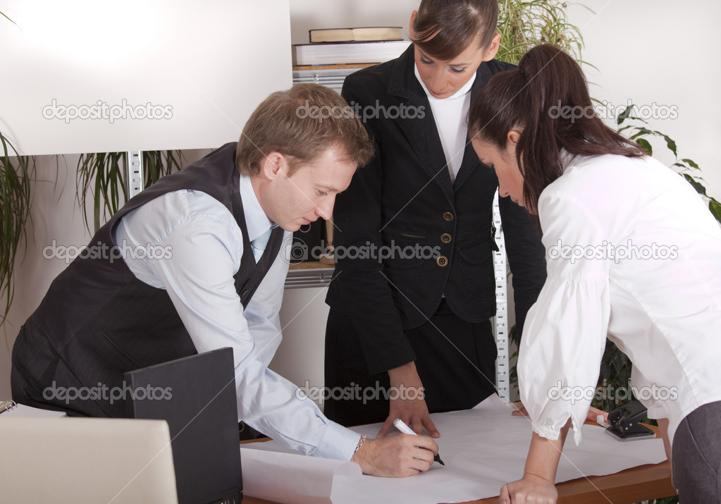 Man and two women discussing about business plan in the office  Stock Photo #1782755