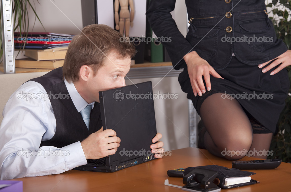 Woman flirting with a man by the work  Stock Photo #1782819