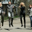 Group of girls jumping — Stock Photo