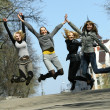 Stock Photo: Group of girls jumping