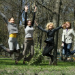 Girls jumping — Stockfoto