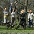 Girls jumping — Stock fotografie