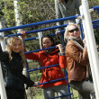 Women on childrens playground — Stock Photo
