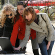 Women friends with laptop outdoor — Стоковое фото