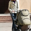 Mother with baby carriage — Stock Photo