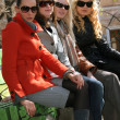 Four women relaxing on the bench — Stock Photo