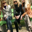 Women friends on a bench — Stock Photo