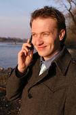 Happy man on cellphone — Stock Photo