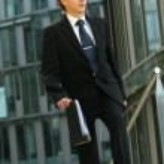 Businessman walking with folder — Stock Photo
