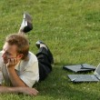 Relaxing businessman on the grass — 图库照片