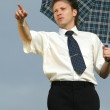 Man with umbrella pointing with finger — Stock Photo #1955887