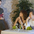 Waitress takes order from couple — Stockfoto
