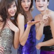 Foto Stock: Party girls flirting