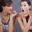 Women eating pizza — Stock Photo
