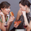Women with sparkling wine and pizzas — Stock Photo