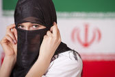 Muslim woman over iran flag — Stock Photo