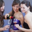 Party girls drinking champagne — Stock Photo