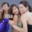 Women dancing with glasses wine — Stock Photo