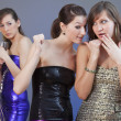 Girls gossiping about other one - Stockfoto