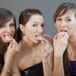 Women eating pizzas — Stock Photo