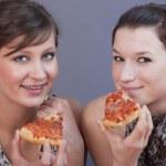 Women eating pizzas — Stock Photo #2533374