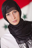 Religious woman over iraq flag — Stock Photo