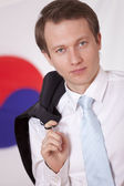 Man with jacket over south korea flag — Stock Photo