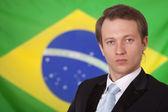 Man over brazilian flag — Stock Photo