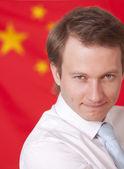 Man over china flag — Stock Photo