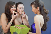 Eating party snacks — Stock Photo
