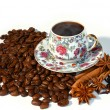 Hot coffee on coffee bean — Stock Photo
