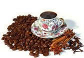 Hot coffee on coffee bean — Stock Photo