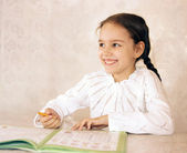 School-girl in pigtails in good spirits — Stock Photo