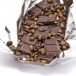 Broken chocolate with coffee bean - Stock Photo