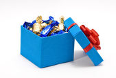 Open blue gift box with sweetmeats — Stock Photo