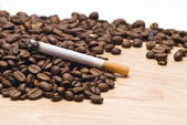 Cigarette and coffee beans — Stock Photo