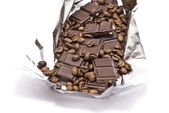 Broken chocolate with coffee bean — Stock Photo