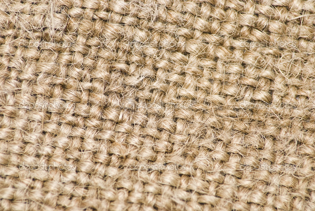 Sackcloth material background. Macro. Selective focus — Stock Photo #1557866
