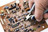 Repairing circuit board — Stock Photo
