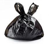 Tied black rubbish bag — Stock Photo