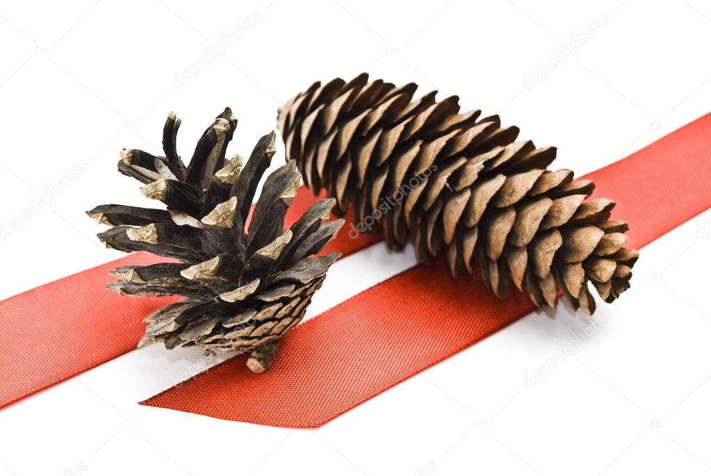 Cones with red ribbons on white — Stock Photo #1606281