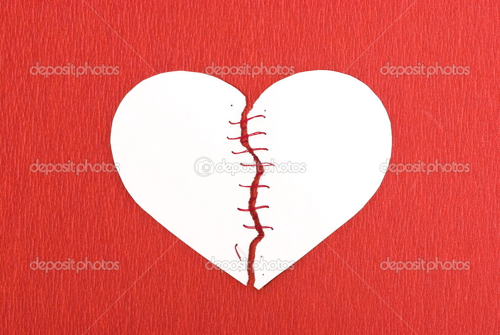 Broken heart on red background — Stock Photo #1619183