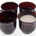 Black cup milk — Stock Photo #1188074