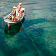 Foto Stock: Boys in boat fish