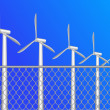 Stock Vector: Wind power behind fence